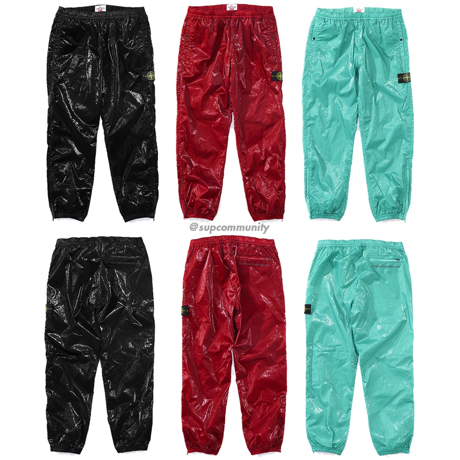 Supreme®/Stone Island® New Silk Light Pant - Water and wind resistant lightweight nylon tela laminated with glossy polyurethane coating and garment dyed. Mesh lining. Hand pockets with snap closures and single zip back pocket. Bottom gussets with zip closure, elastic cuffs and waistband with int...