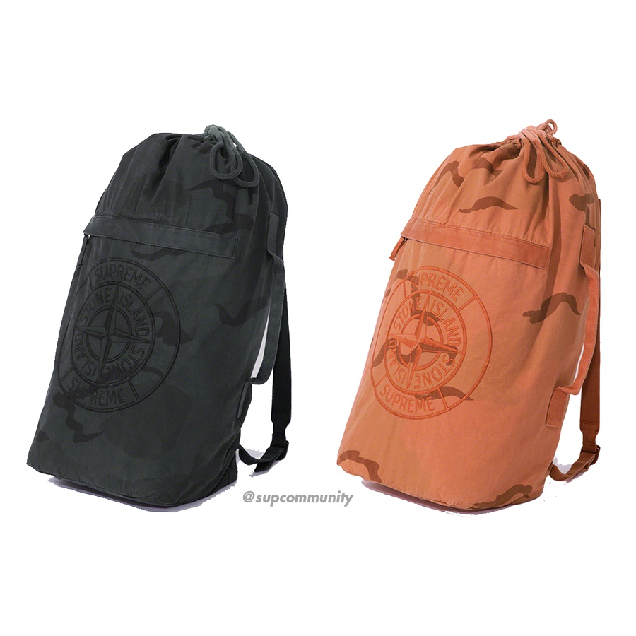 Supreme®/Stone Island® Camo Backpack - Brushed cotton canvas backpack with printed pattern and pigment overdye. Drawstring top closure with zip pockets at front and back. Embroidered logos on front. Made exclusively for Supreme.
