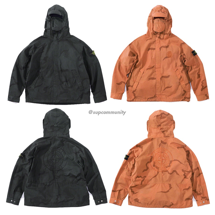 Supreme®/Stone Island® Riot Mask Camo Jacket - Water resistant brushed cotton canvas with printed pattern and pigment overdye. Full zip closure with snap placket and hand pockets at lower front. Fixed hood with rigid visor and velcro side flaps. Interior elastic shock cords at hood and hem. Remova...
