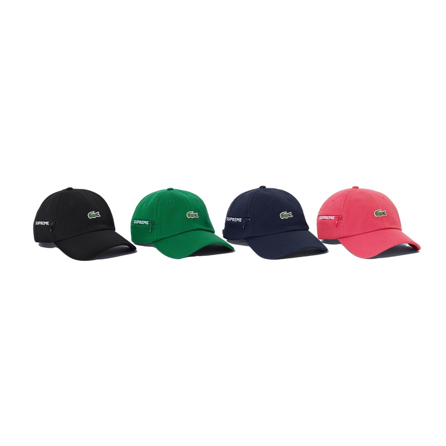 Supreme®/LACOSTE Pique 6-Panel - All cotton pique 6-panel hat with self strap closure. Zip side pocket with jacquard logo zipper tape. Embroidered logo patch on front. Made exclusively for Supreme.