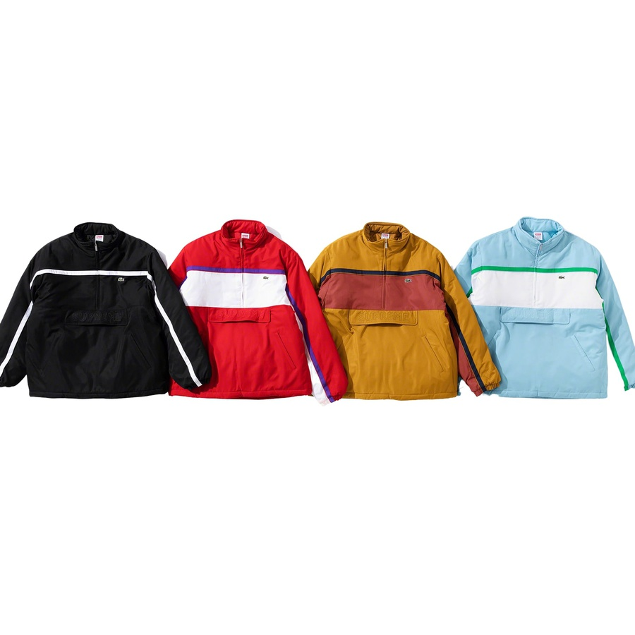 Supreme®/LACOSTE Puffy Half Zip Pullover - Water repellant poly with fill and quilted taffeta lining. Half zip closure with zip hand pockets at lower front and zip pouch pocket with velcro placket. Elastic cuffs with interior elastic shockcords at hem. Contrast piping and panels with embroider...