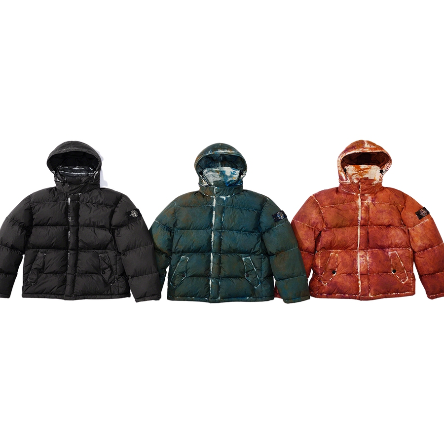 Supreme®/Stone Island® Painted Camo Crinkle Down Jacket - Water and wind resistant lightweight nylon with resin-coated inner facing that results in crinkled texture. Unique camouflage pattern acheived through garment dyeing and Stone Island® shooting technique. Direct-injected down interior quilted baffles. ...
