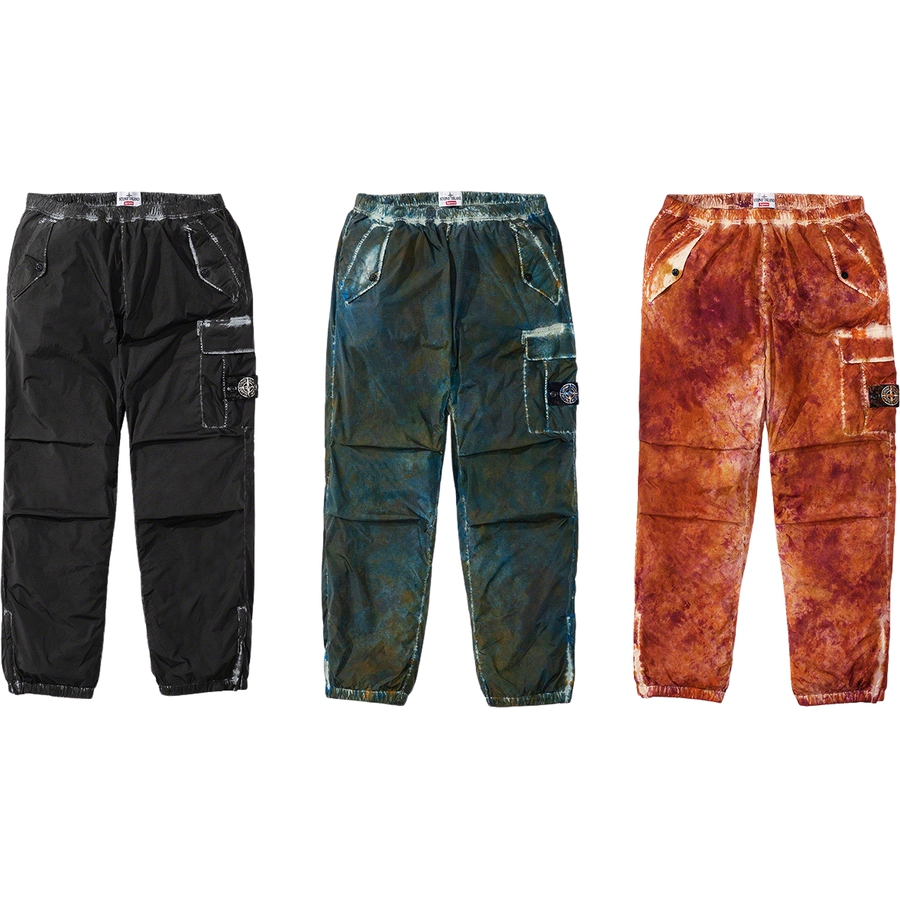 Supreme®/Stone Island® Painted Camo Nylon Cargo Pant - Water and wind resistant lightweight nylon with resin-coated inner facing that results in crinkled texture. Unique camouflage pattern achieved through garment dyeing and Stone Island® shooting technique. Nylon canvas lining. Snap flap hand pockets, ve...