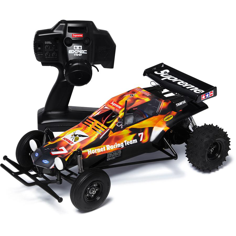 Supreme®/Tamiya Hornet RC Car - Two-wheel drive remote control car. RS 540 motor and pin-spike tire treads for on and off-road terrain. Shock absorbent polycarbonate body with lightweight, durable ABS resin bathtub frame and side bumpers. Controller included. Assembly required. 15.7...