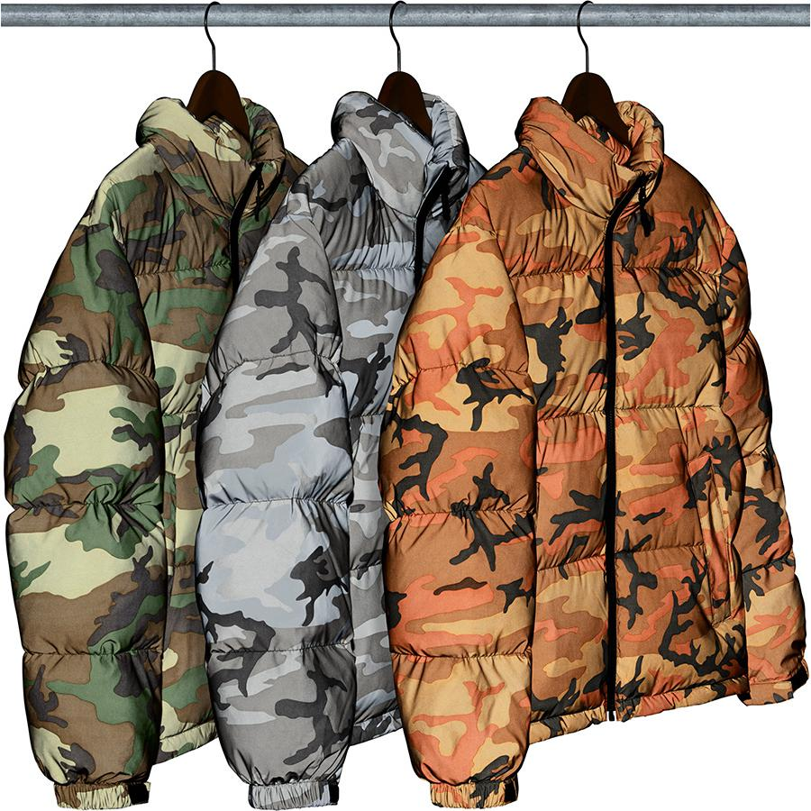 Reflective Camo Down Jacket - Reflective printed poly with down fill, taffeta lining and full zip closure. Packable hood with jacquard logo zipper tape at back neck. Zip hand pockets at lower front and interior zip chest pocket. Velcro strap adjusters at cuffs with interior shockc...