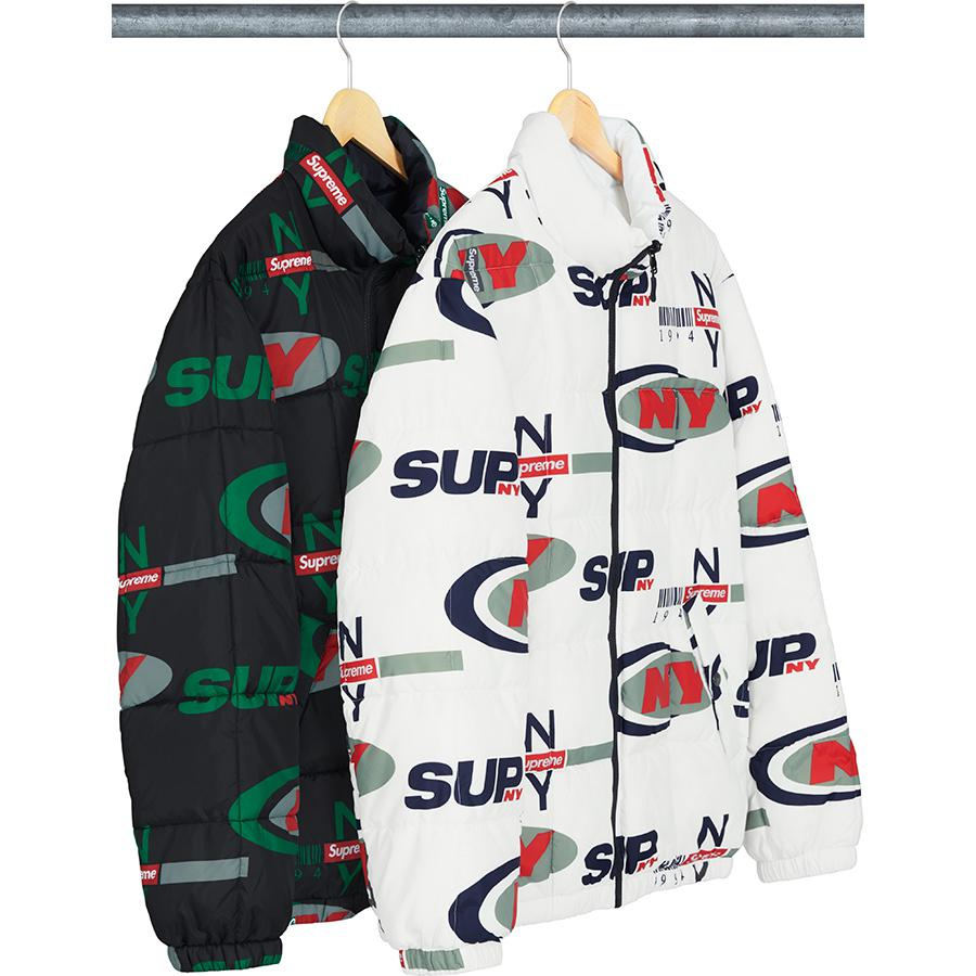 Supreme NY Reversible Puffy Jacket - Water resistant poly with insulated fill and full zip closure. Hand pockets at lower front with snap closure. Zip hand pockets at lower front and chest on reverse side. Elastic cuffs and hem with embroidered logo patch on chest.
