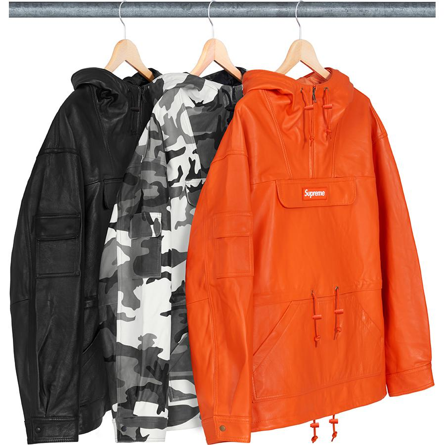 Leather Anorak - Lambskin leather with satin lining and half zip closure. Chest pocket with zip closure and snap flap, pouch pocket at lower front and patch pocket on right sleeve with snap closures. Drawcord at hood, waist and hem. Woven logo patch on chest.