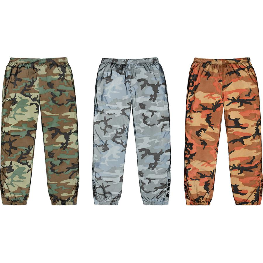 Reflective Camo Warm Up Pant - Reflective printed poly with mesh and taffeta lining. On seam hand pockets and single back zip pocket. Bottom gussets with zipper closure, elastic cuffs and waistband with interior drawcord and interior hanging key pocket. Printed logo on lower legs.