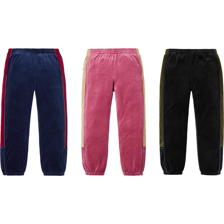Velour Track Pant - Cotton blend velour with contrast side panels and piping. On seam hand pockets and single back patch pocket. Bottom gussets with zipper closure, elastic cuffs and waistband with interior drawcord. Embroidered logo on lower legs.