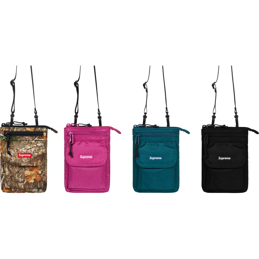 "Shoulder Bag - Water resistant 630D HT Cordura® nylon with embossed logo lining. Main zip compartment with internal zip pocket. Zip pocket and velcro flap patch pocket at front. Adjustable shoulder strap and carabiner at back. Woven logo label at front.  5.5"" x 8.25"""