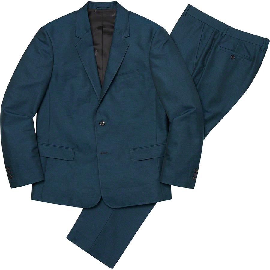 Sharkskin Suit - Wool blend with jacquard logo viscose lining. Jacket with double welt flap hand pockets at hip, single welt chest pocket and interior chest pockets. Notch lapel, functional buttons and vent at back seam. Half lined trousers with hook closure and zip f...