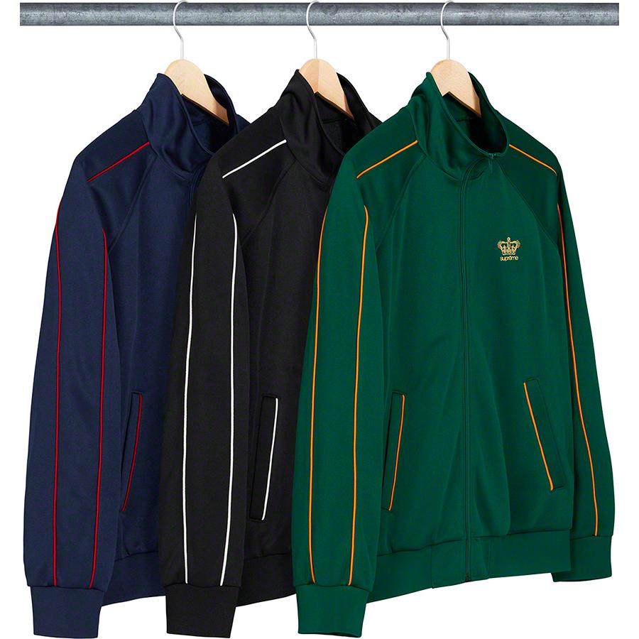 Crown Track Jacket - Poly with full zip closure and hand pockets at lower front. Contrast piping with knit rib cuffs and hem. Embroidered logo on chest.