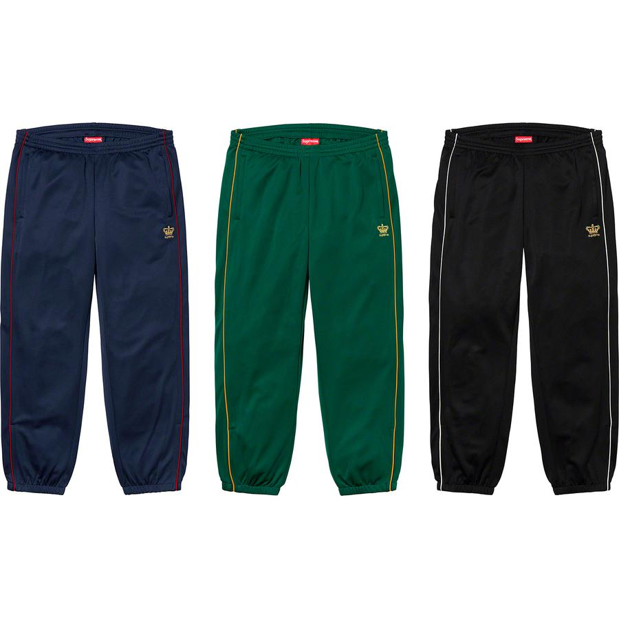 Crown Track Pant - Poly with zip hand pockets and single back zip pocket. Bottom gussets with zip closure, elastic cuffs and waistband with interior drawcord. Contrast piping and embroidered logo on thigh.