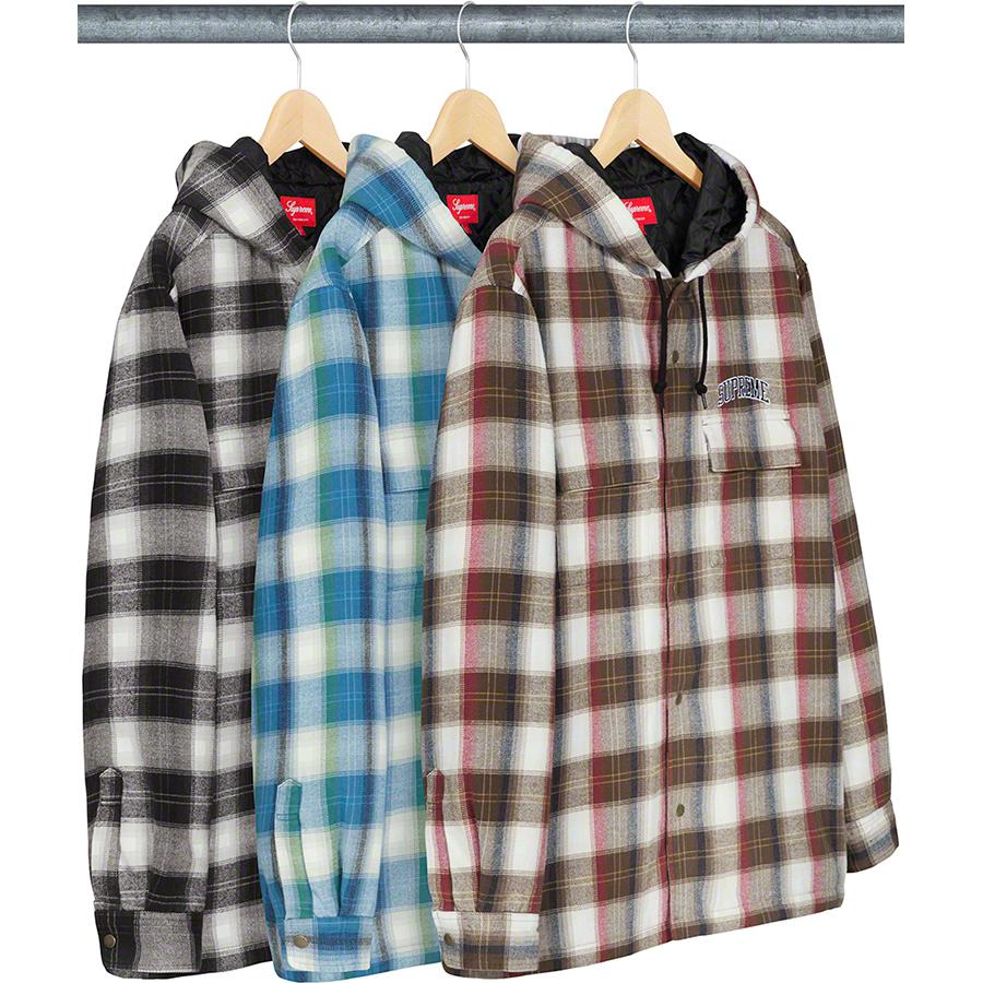 Quilted Hooded Plaid Shirt - All cotton flannel with fill and quilted taffeta lining. Snap front closure with on seam hand pockets at lower front and snap flap pockets at chest. Embroidered logo on chest.
