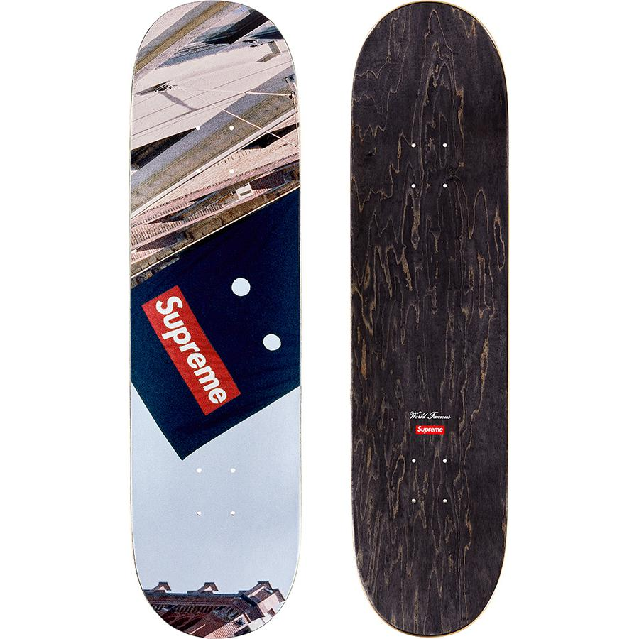 Banner Skateboard - Supreme skate deck with natural veneer and black top ply. Printed graphic on bottom with printed World Famous and box logo on top.