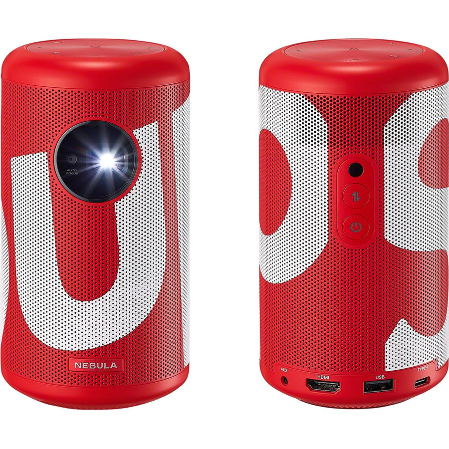 Supreme®/Anker Nebula Capsule II Projector - Portable projector with 200 ANSI lumen bulb and 16:9 HD resolution. Built-in speaker with printed logo. Video play time up to 2.5 hours. All orders include EU charger only. Made exclusively for Supreme.
