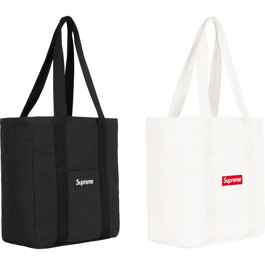 Canvas Tote - All cotton heavyweight 18 oz. canvas with cotton twill lining and zip top closure. Interior zip pocket and additional pocket at front. Woven logo label at front. 22L.