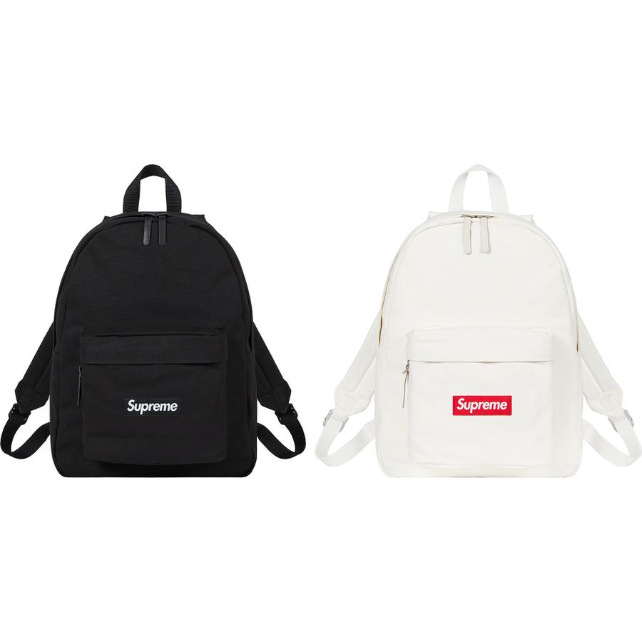 Canvas Backpack - All cotton heavyweight 18 oz. canvas with cotton twill lining. Main zip compartment and front zip pocket. Woven logo label at front. 20L.
