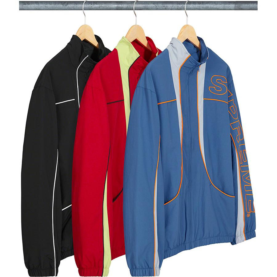 Piping Track Jacket - Water resistant Supplex® nylon taslan with mesh and taffeta lining. Full zip closure with on seam hand pockets at lower front. Elastic cuffs and hem with contrast panels and piping. Embroidered logo on left sleeve.