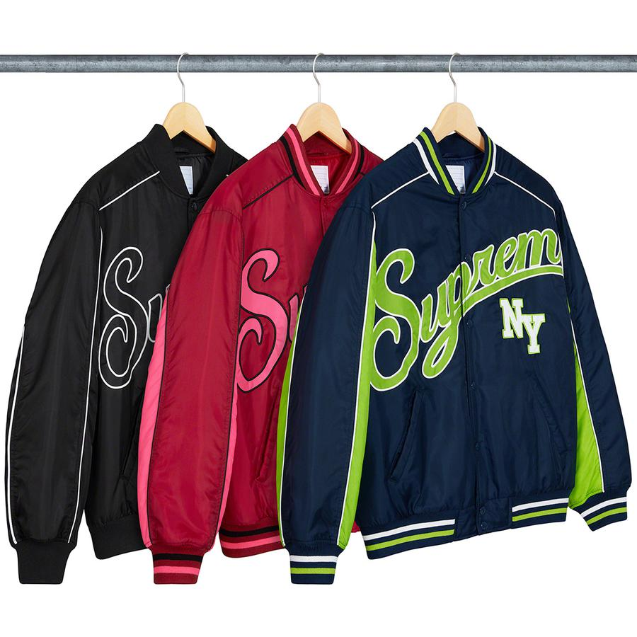 Contrast Script Varsity Jacket - Water resistant nylon with fill and quilted taffeta lining. Snap front closure with hand pockets at lower front and interior chest pocket. Stripe rib collar, cuffs and hem with appliqué logo on chest.