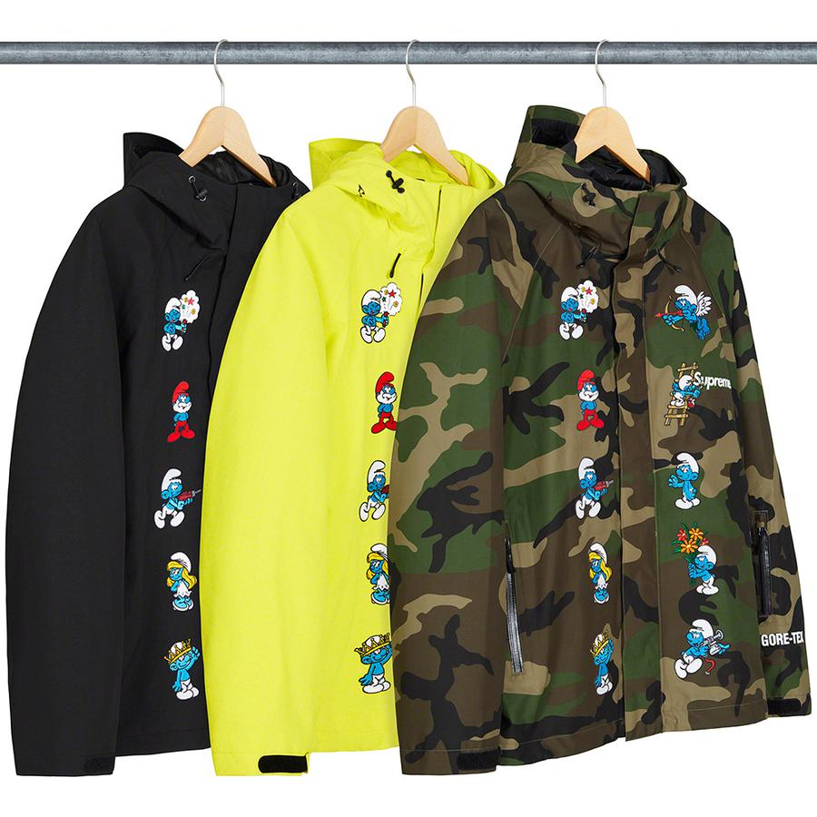 Supreme®/Smurfs™ GORE-TEX Shell Jacket - Waterproof, breathable GORE-TEX nylon 2-layer shell with taped seams and embossed logo lining. Full zip closure with velcro placket. Zip hand pockets at lower front and zip stash pocket at sleeve. Interior elastic shockcord at hood and hem with velcro...