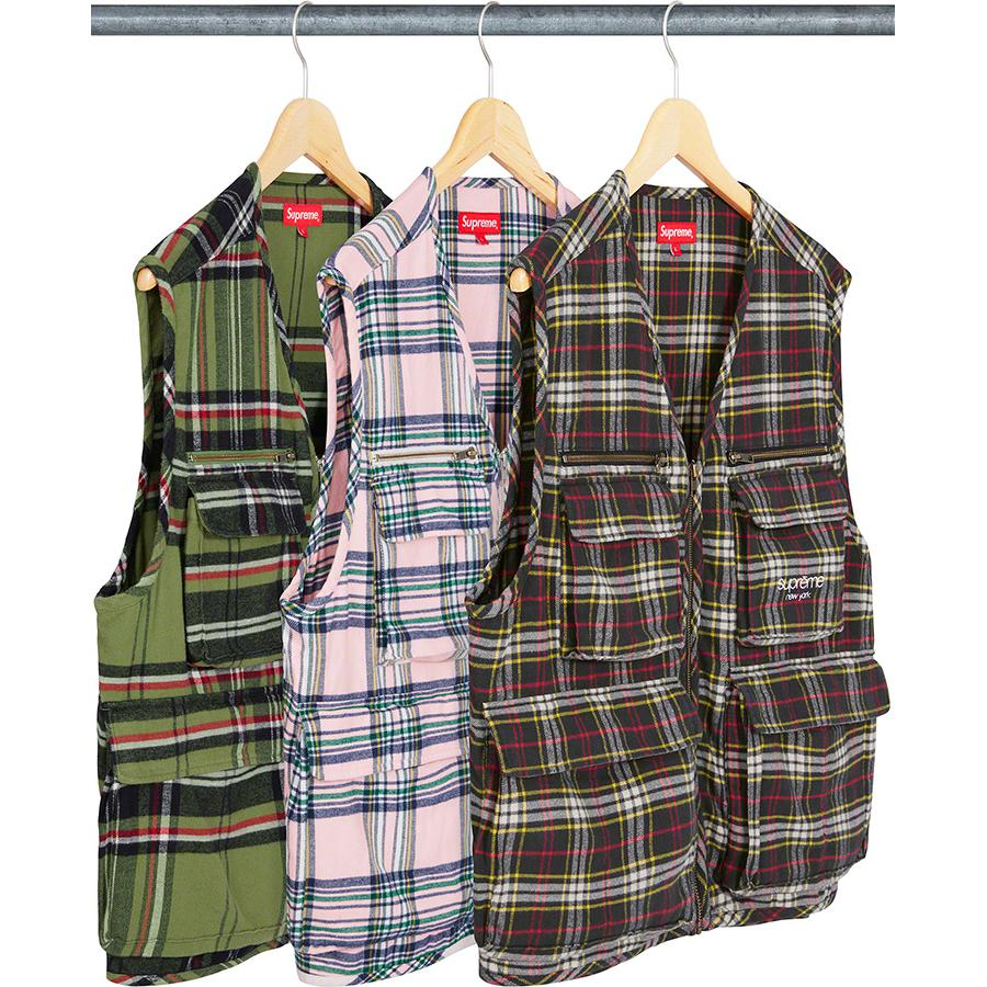 Tartan Flannel Cargo Vest - All cotton flannel with full zip closure. Velcro flap patch pockets at lower front with dual top and side entry. Velcro flap patch pockets and zip pockets at chest. Interior zip pocket and zip pocket at back. Embroidered logo on left chest pocket.