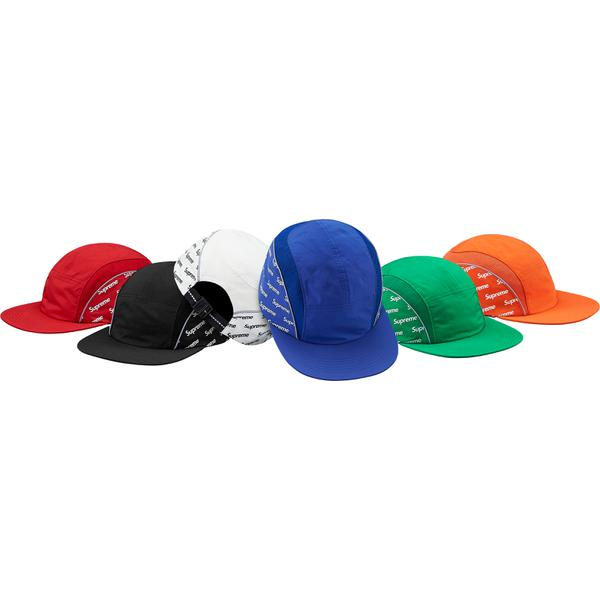 Diagonal Logo Side Panel Camp Cap - Poly blend Supreme camp cap with mesh and 3M® Reflective piping on sides. Reflective webbing strap closure and printed logos on side.