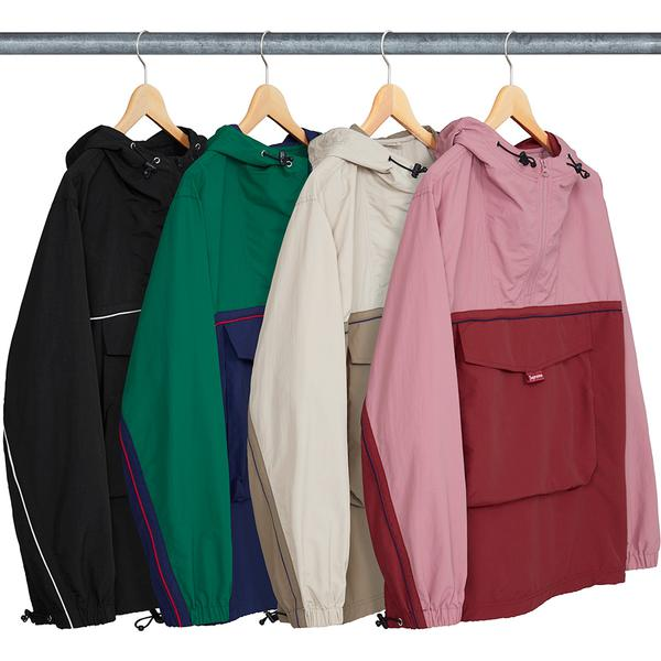 Split Anorak - Water resistant nylon taslan with half zip construction. Contrast panel and piping on chest and sleeves. Patch pocket on front with velcro flap and zipper closure at top entry. Elastic drawcord at hood and hem with elastic cuffs. Embroidered logo on hood.