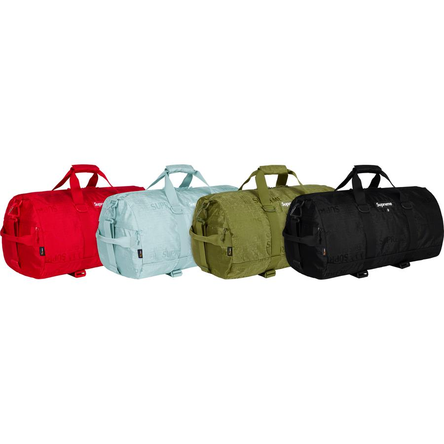 Duffle Bag - Cordura® nylon with jacquard logo pattern and embossed logo lining. Main zip compartment with internal mesh zip pocket. Zip compartments on sides with front velcro pocket. Adjustable velcro straps on bottom for skateboard. 36L.
