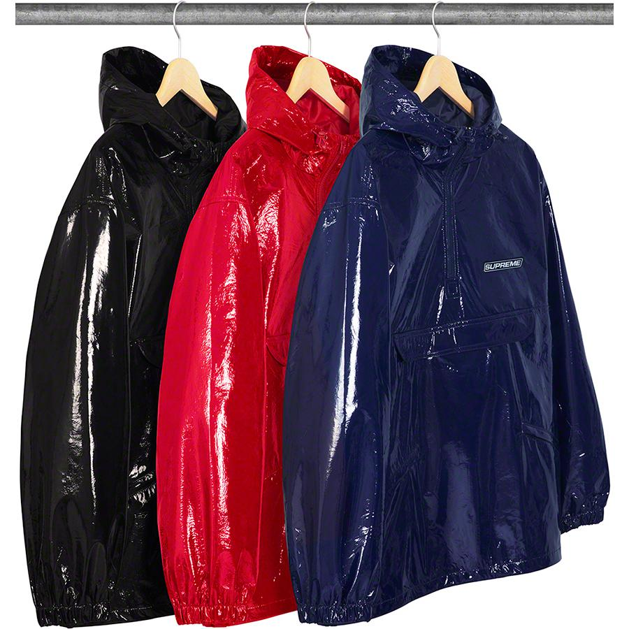 Crinkle Anorak - Laminated poly blend with taffeta lining and half zip closure. Zip hand pockets at lower front and pouch pocket at chest. Interior shockcords at hood and hem. 3M® Reflective rubber logo patch on chest and back.