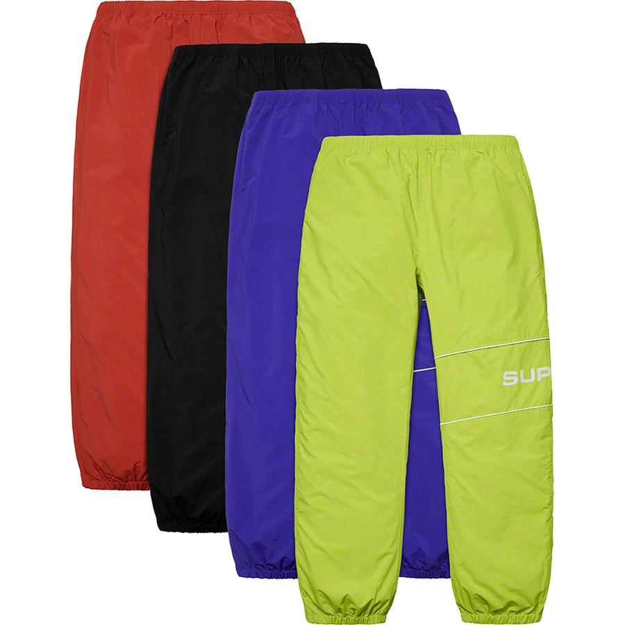 Nylon Ripstop Pant - Water resistant nylon ripstop with mesh and taffeta lining. On seam hand pockets and back zip patch pocket with jacquard logo zipper tape. Bottom gussets with zip closure, elastic cuffs and waistband with interior drawcord and interior hanging key poc...