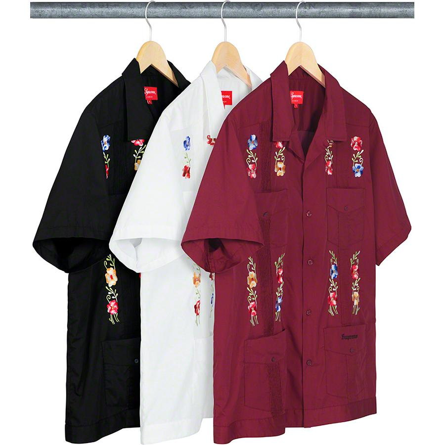 Flowers Guayabera S/S Shirt - Cotton blend with front pintucks and embroidered graphic. Patch pockets with button closures at chest and lower front. Embroidered logo on bottom left pocket.