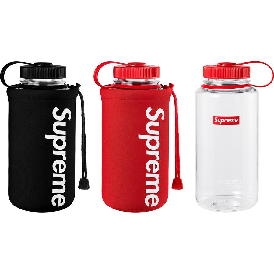 Supreme®/Nalgene® 32 oz. Bottle - 32 oz. BPA free Tritan polymer wide-mouth water bottle with printed logo. Neoprene sleeve with drawcord, D-ring and printed logo. Made exclusively for Supreme.