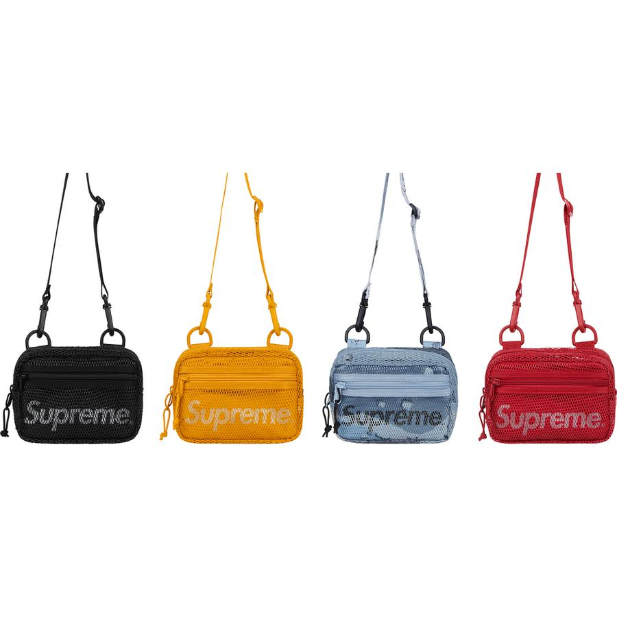 Small Shoulder Bag - 610D Cordura® poly with PVC-coated mesh and embossed logo lining. Main zip compartment and front zip pocket. Adjustable shoulder strap. 3M® Reflective printed logo at front. 0.9L.