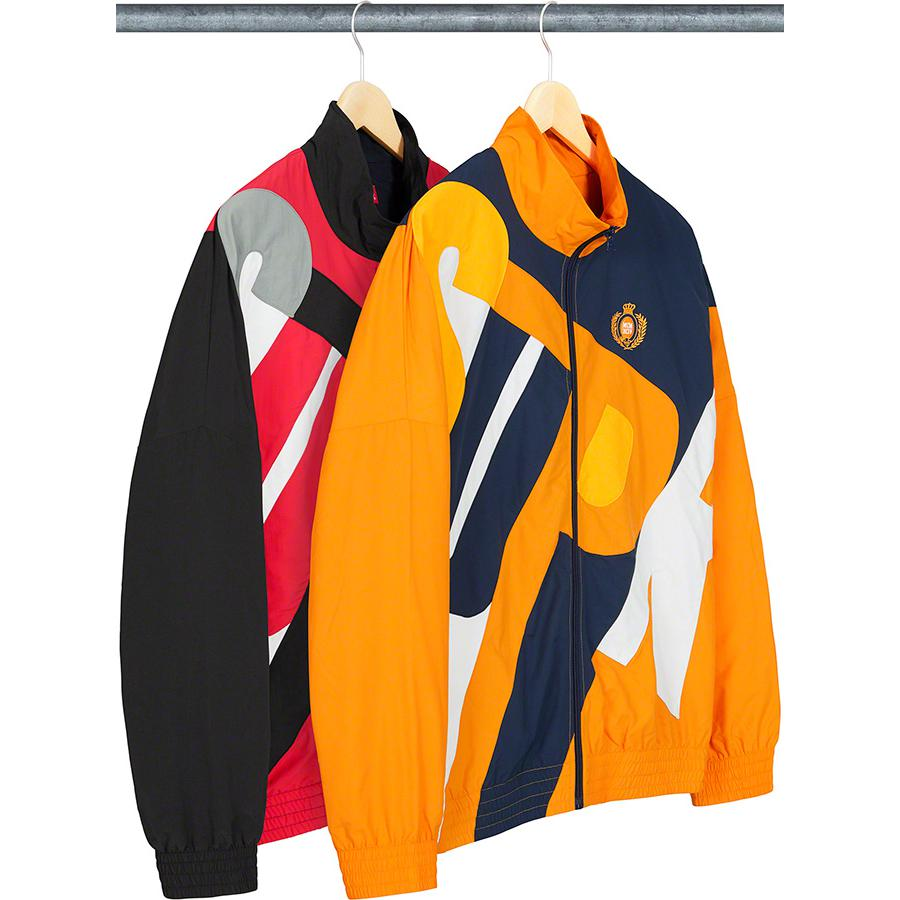 Big Letter Track Jacket - Water resistant Supplex® nylon taslan with cotton jersey lining and taffeta sleeve lining. Full zip closure with on seam hand pockets and interior chest pocket. Elastic cuffs and hem. Pieced-in logo at front and back with embroidered logo on chest.