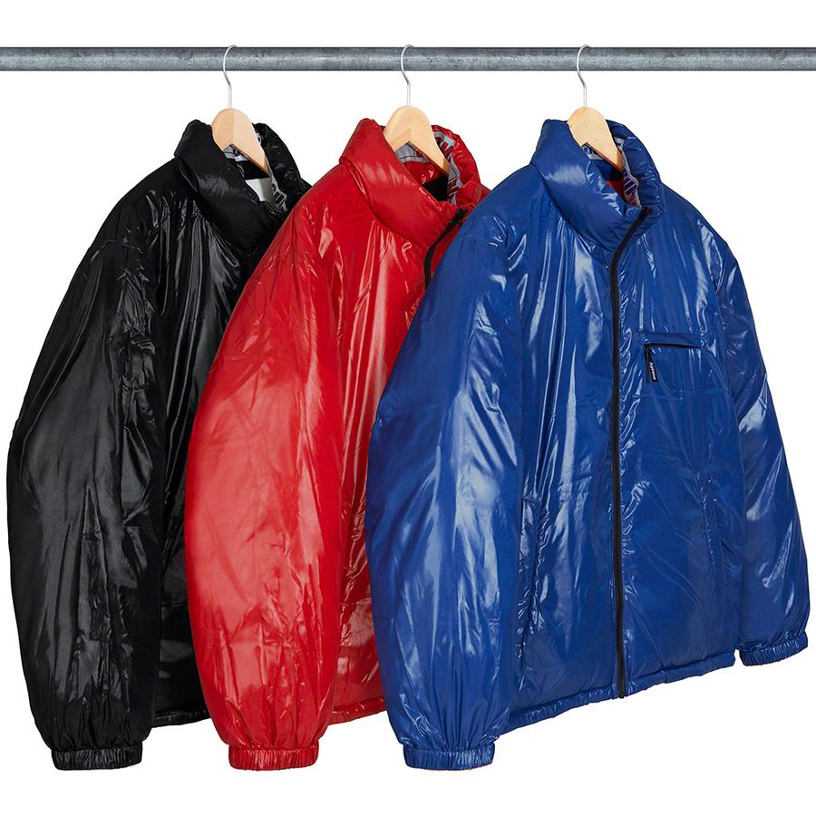 Shiny Reversible Puffy Jacket - Water resistant nylon with down filled quilted baffles. Full zip closure with zip hand pockets at lower front. Reverse side with hand pockets and zip chest pocket. Elastic cuffs with interior elastic shockcord at hem. Reflective logo taping at neck.