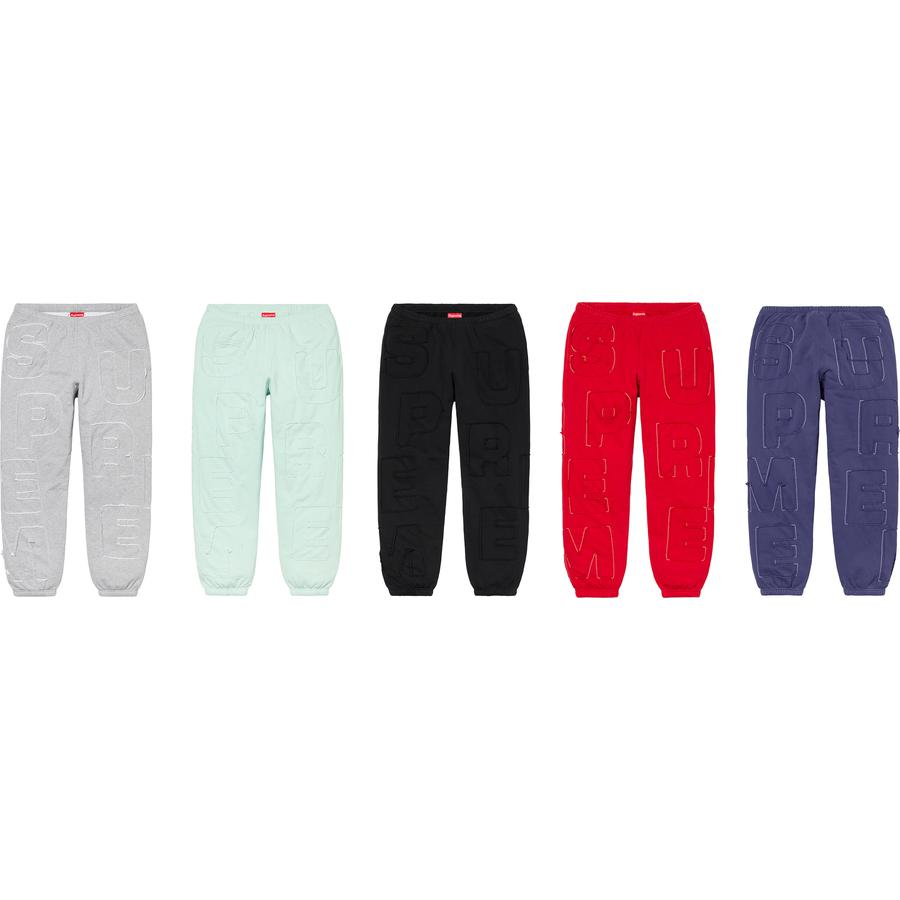 Cutout Letters Sweatpant - Cotton fleece with inset appliqué logo pattern. On seam hand pockets and single back patch pocket. Elastic cuffs and waistband with interior drawcord.