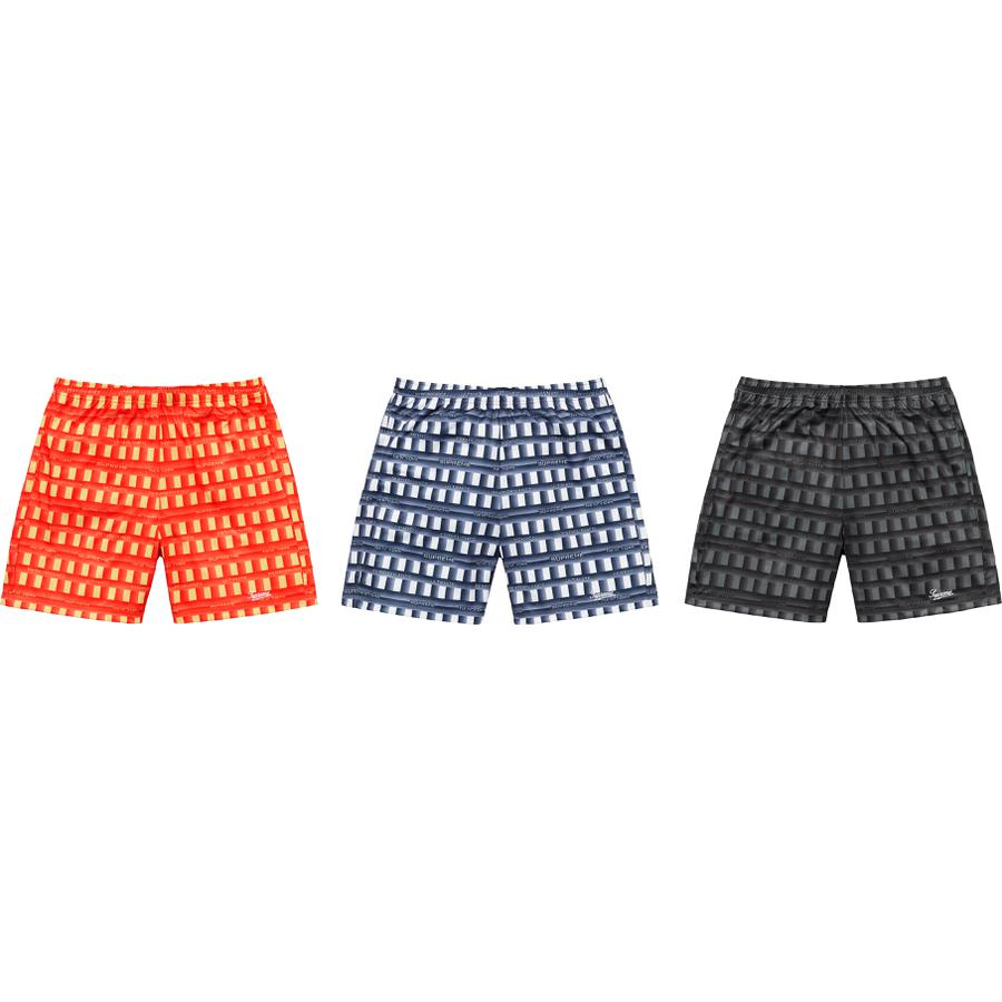 Grid Soccer Short - Poly with printed logo pattern. On seam hand pockets and single back zip pocket. Elastic waistband with interior drawcord. Embroidered logo at lower leg.