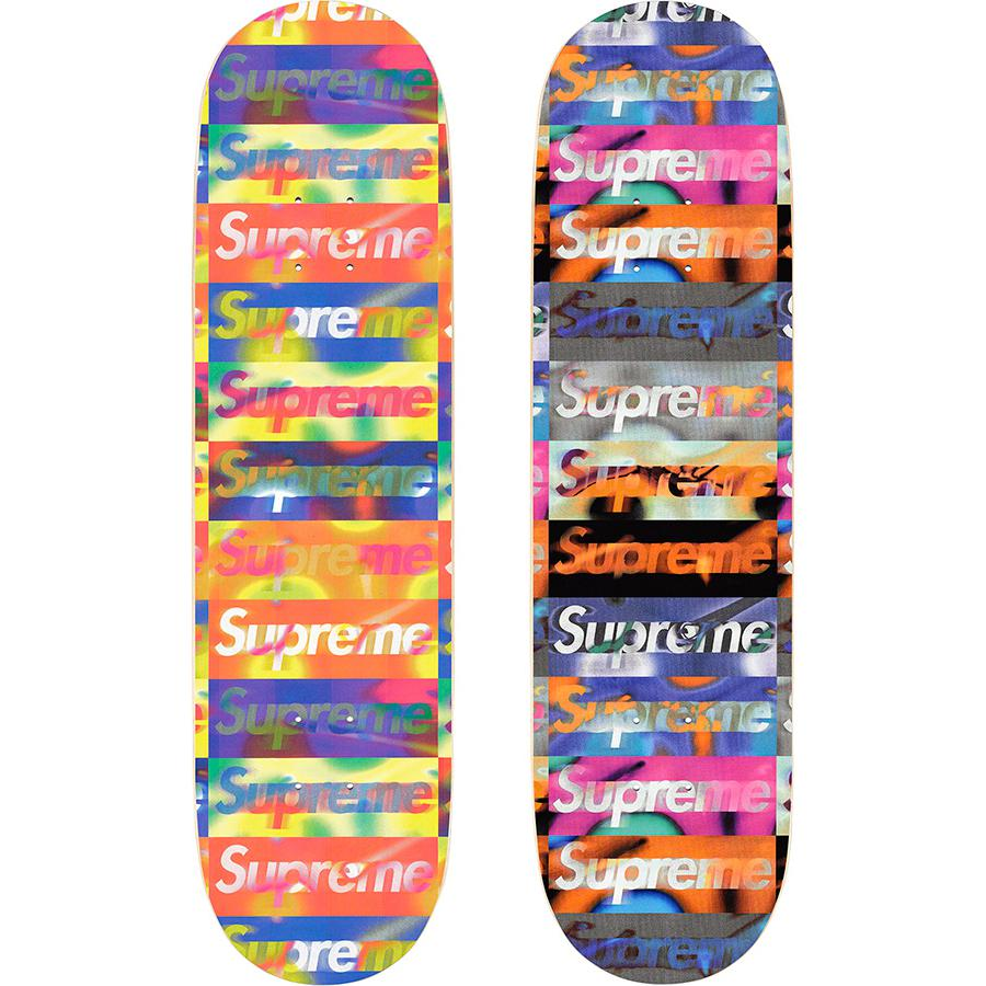 Distorted Logo Skateboard - Supreme skate deck with natural veneer and black top ply. Printed logo pattern on bottom with printed World Famous and box logo on top.